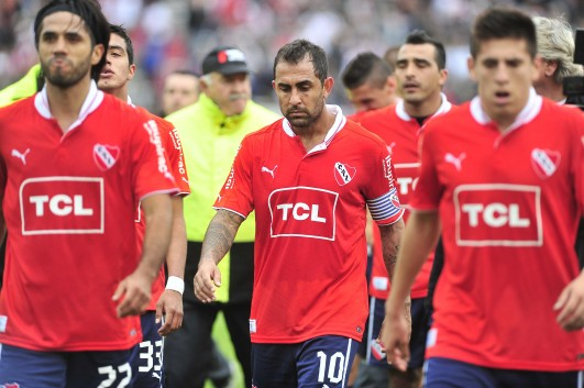 Independiente's players leave the pitch after their relegation is confirmed